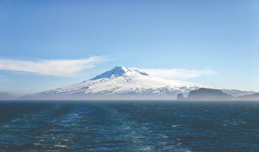 Shutterstock_1095510842_Beerenberg volcano on a foggy morning on Jan Mayen